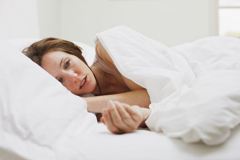 This image has an empty alt attribute; its file name is sickwomaninbed-56b1e9843df78cdfa003291b.jpg